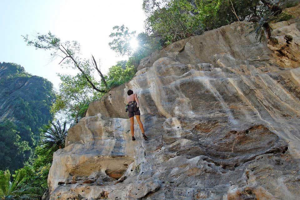 Guy rock climbing in Tonsai