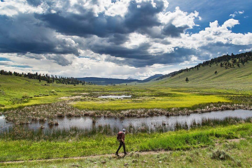 A man hiking through fields