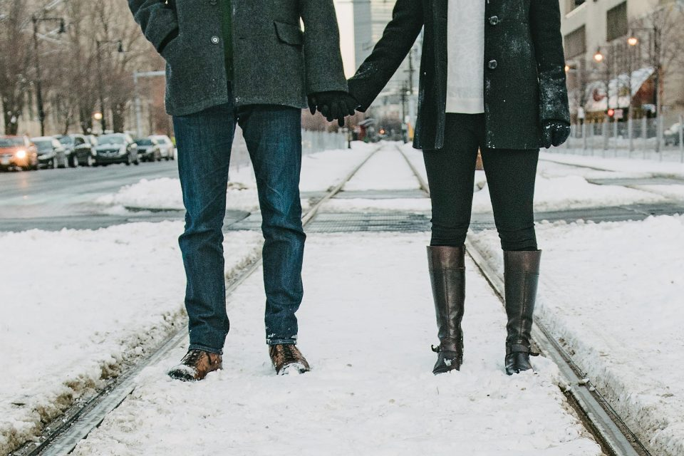 A couple holding hands in the snow
