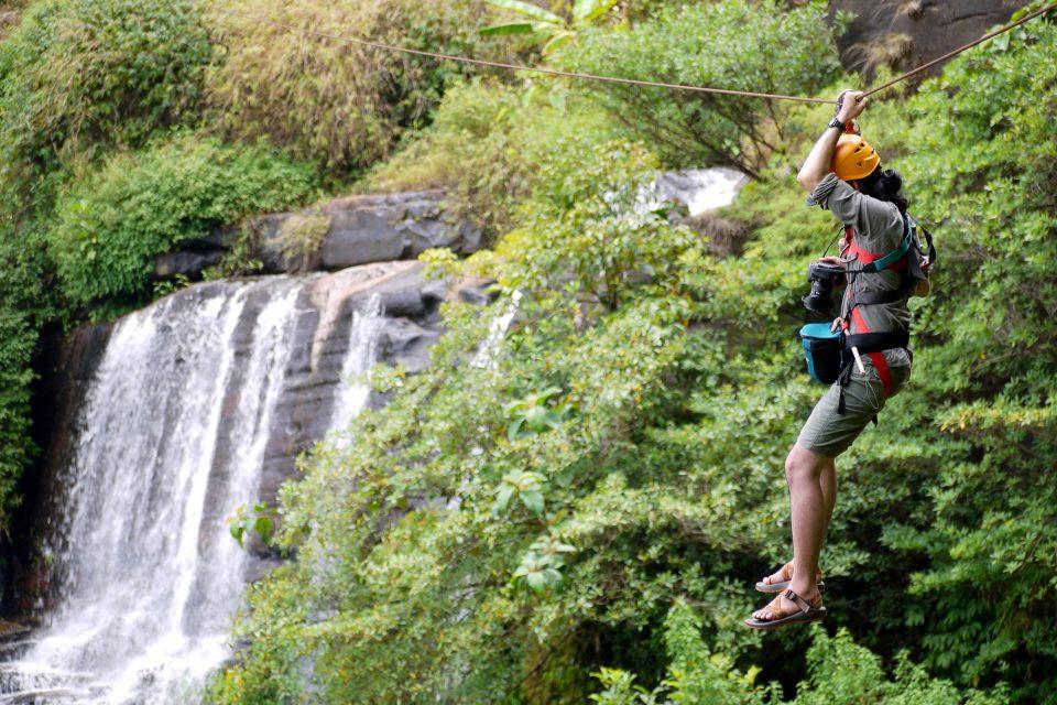 Woman slides down zipline in Laos
