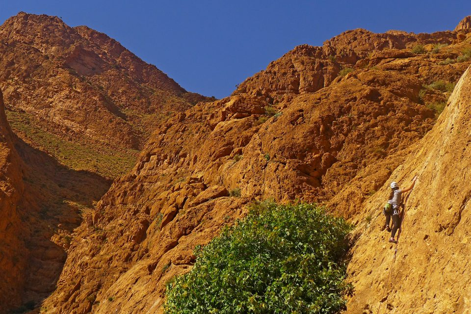 Girl climbs a rock in Morocco