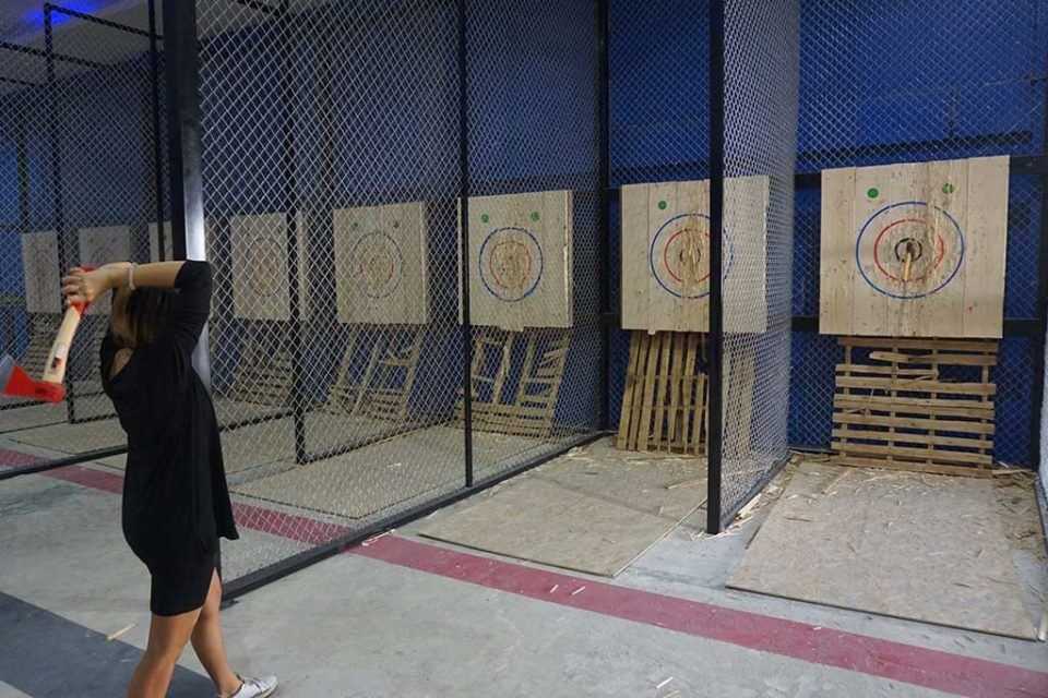 Girl axe throwing in Bangkok