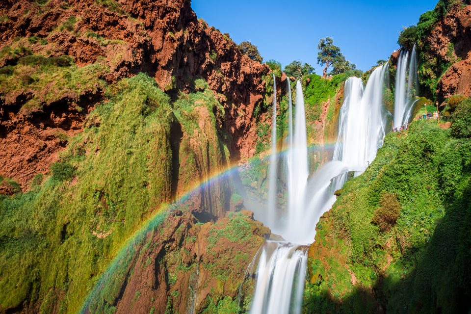 Rainbow shines over waterfall