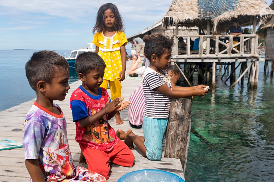 Children on Sawinggrai island, Raja Ampat, Indonesia