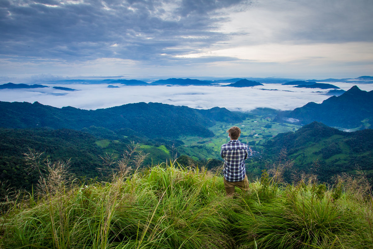 Standing Above The Clouds At Phu Chi Fa In Northern Thailand