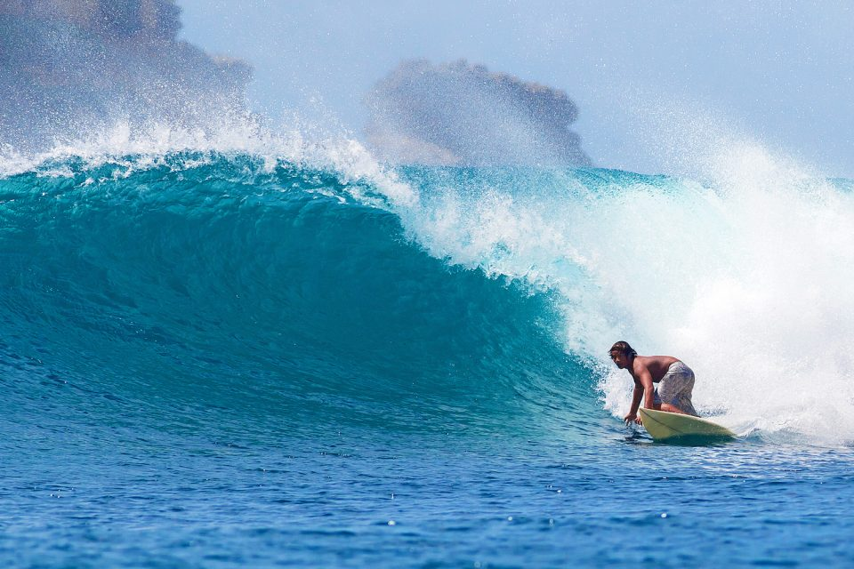 Surfing at beach on Lombok, Indonesia