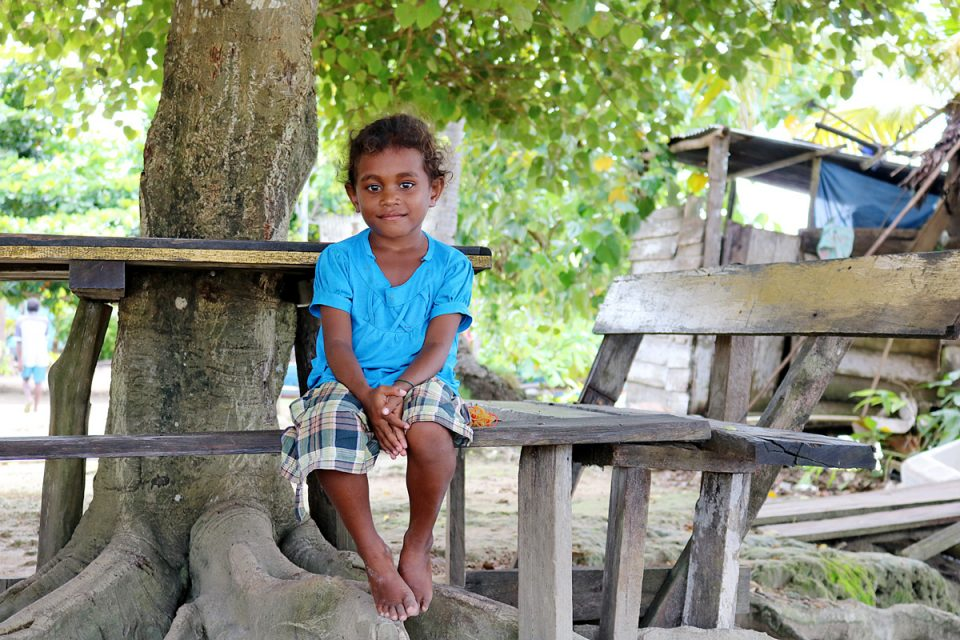 Young girl on Sawinggrai island, Raja Ampat, Indonesia