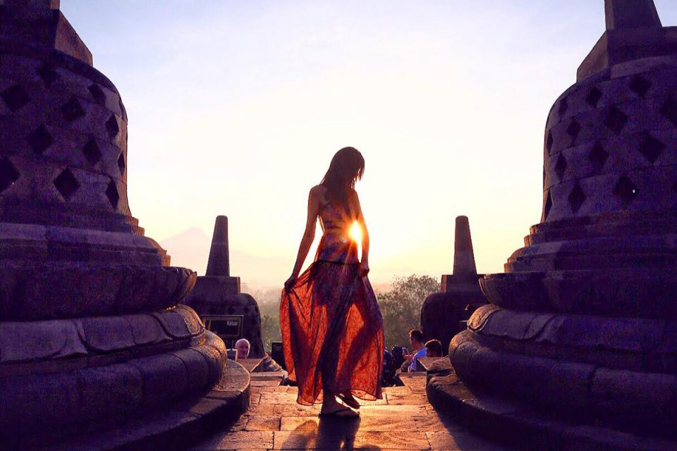 Girl in dress, sunrise at Borobudur, Indonesia
