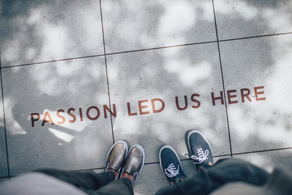 "A pavement with the words ""passion led us here"" written on it"