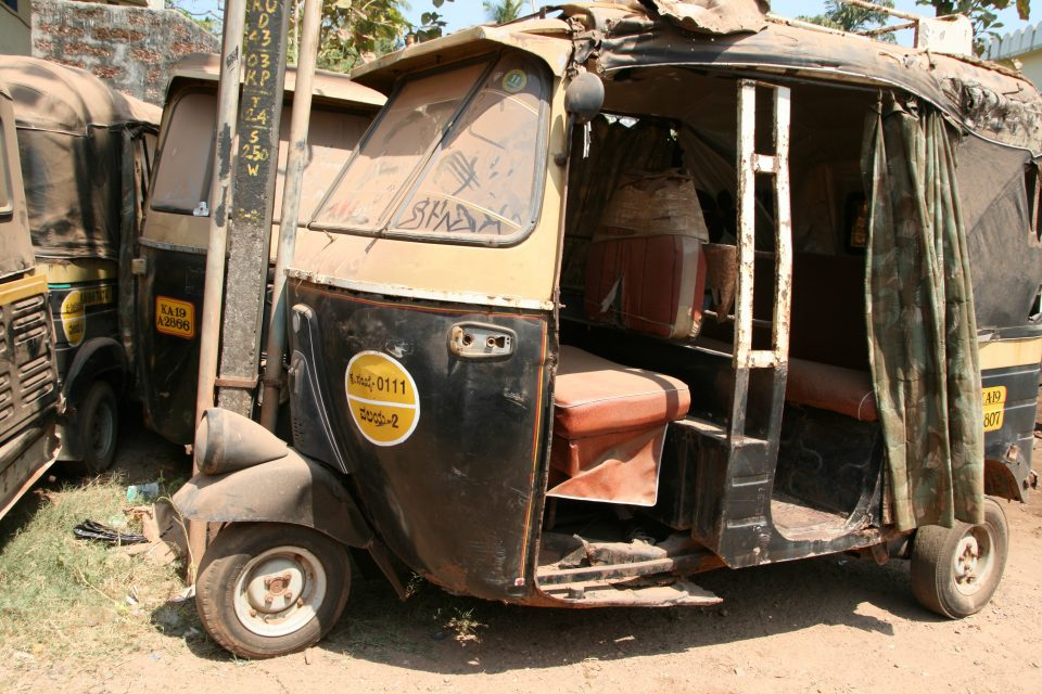 A dis-used dusty moto rickshaw