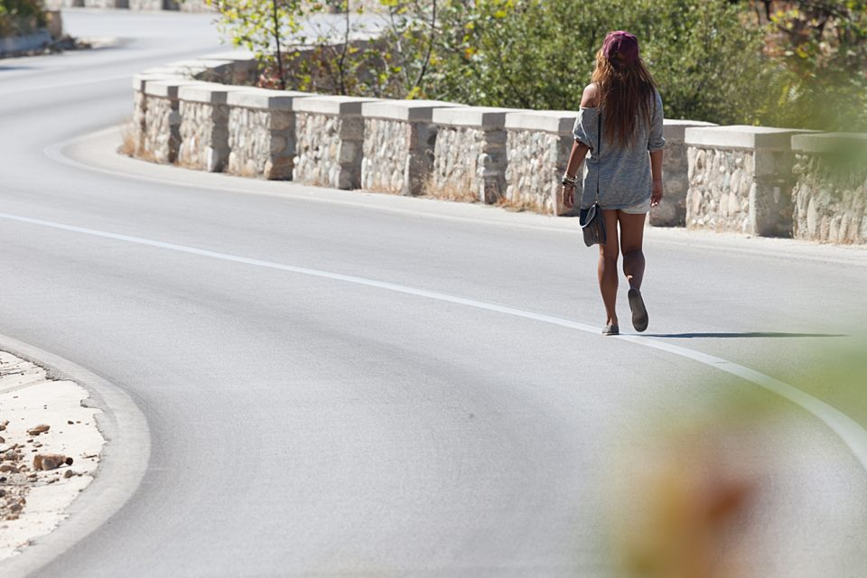 A woman walking on the road