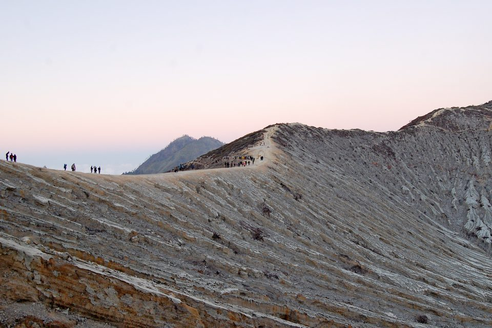 A group of people trekking over the volcano