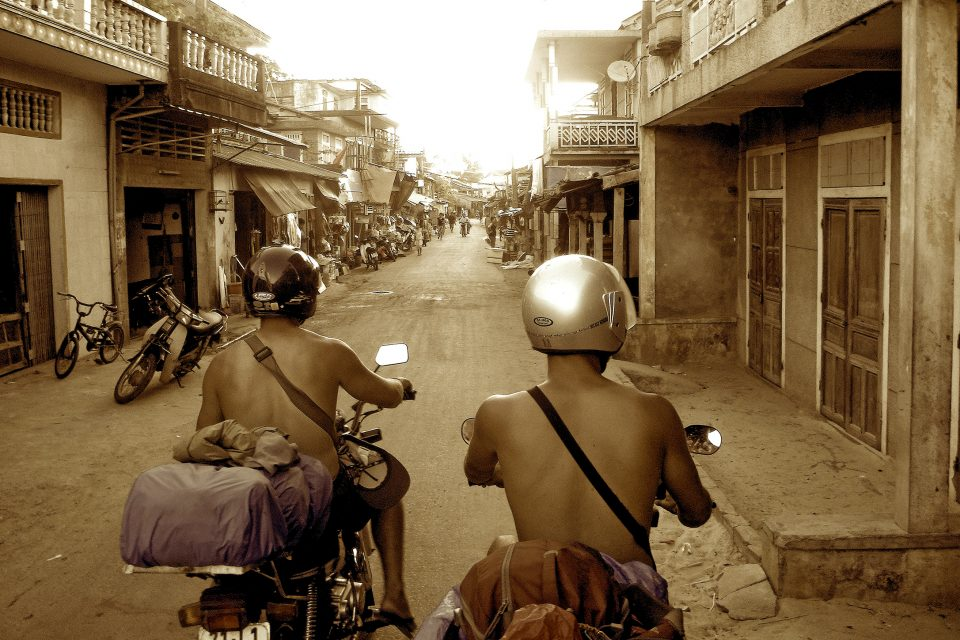 Two men on motorbikes