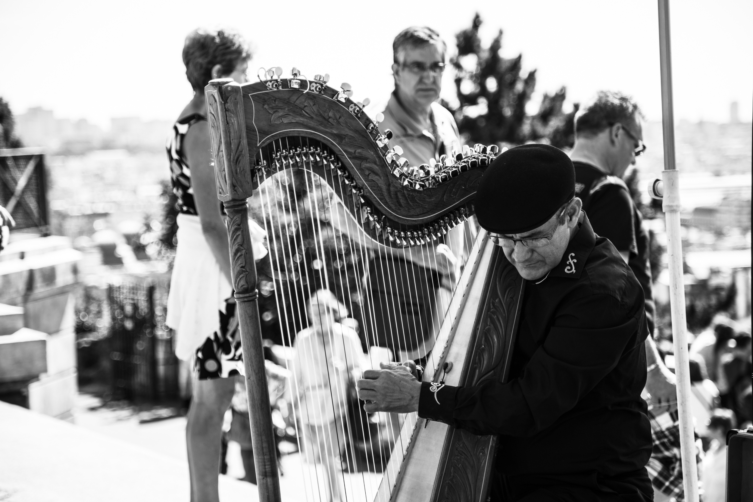A local man playing a harp