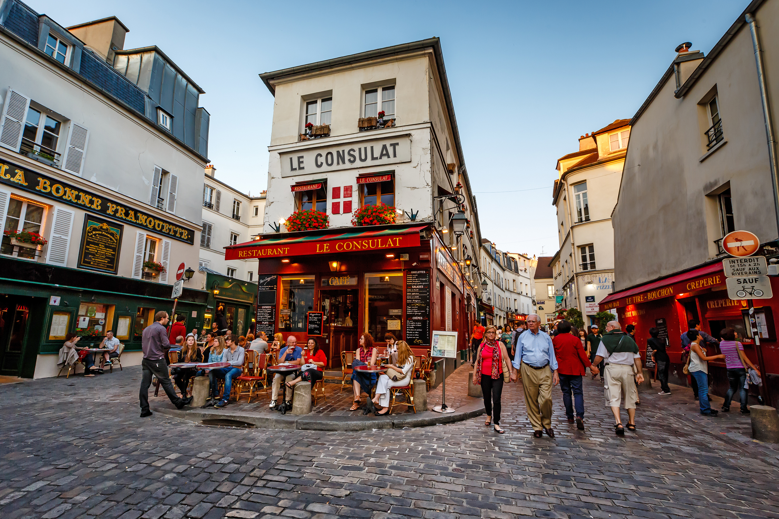 A local street in Paris full of restaurants
