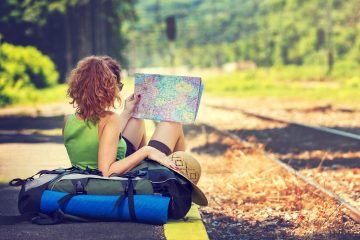 A female backpacker looking at a map