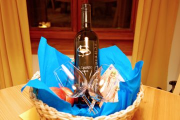 Hotel welcome basket with wine