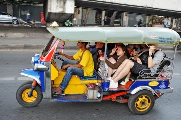A tuk tuk crowded with people
