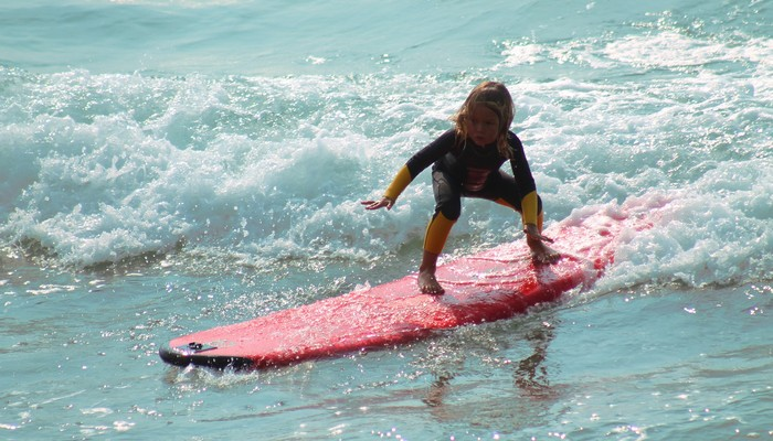 Unique Volunteer surfing kids camp