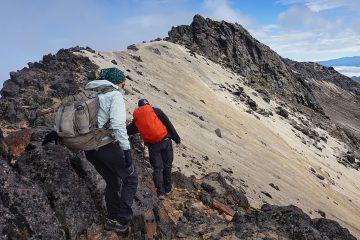 Couple hiking mountain in hiking gear
