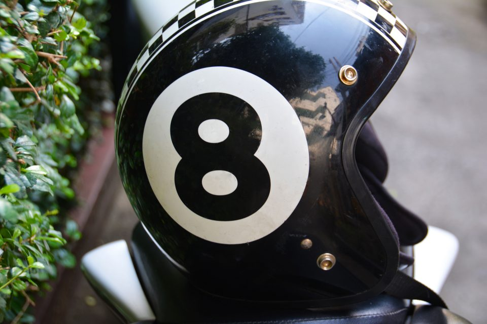 Close up of a black motorbike helmet