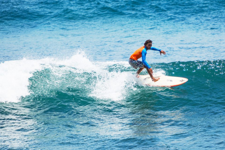 A man surfing in Balangan