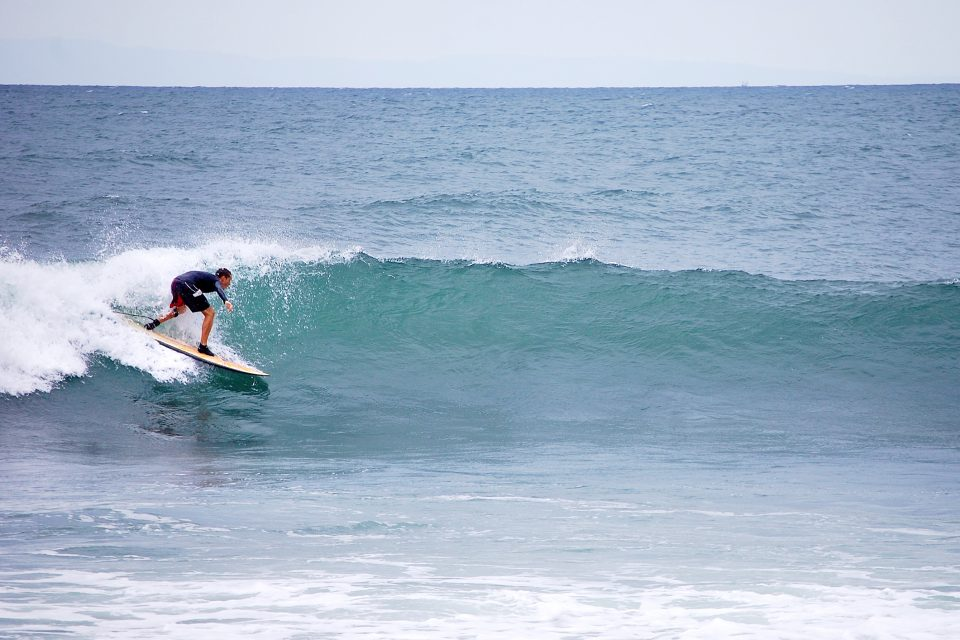 A man surfing in Medewi