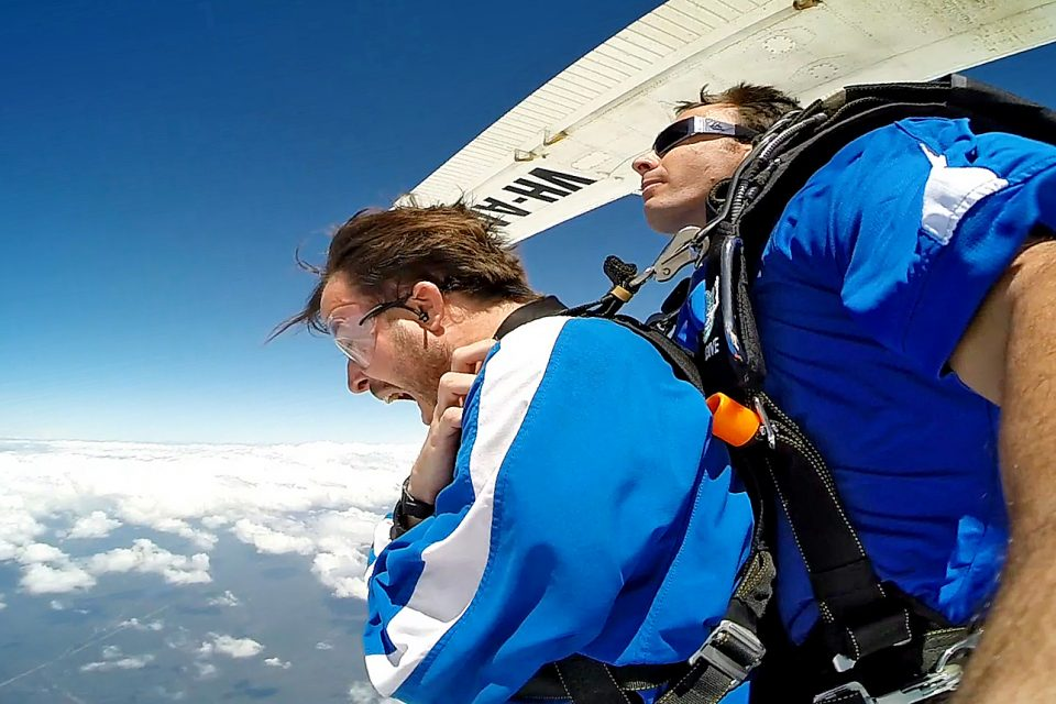 Two men jumping out of a plane