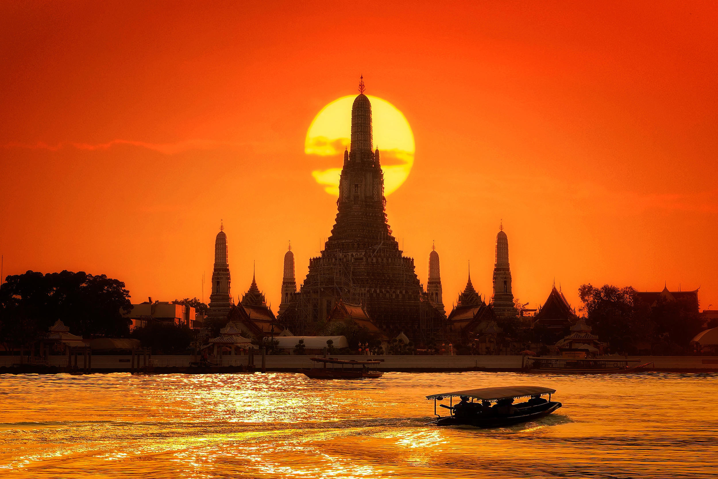 A temple on the water at sunset