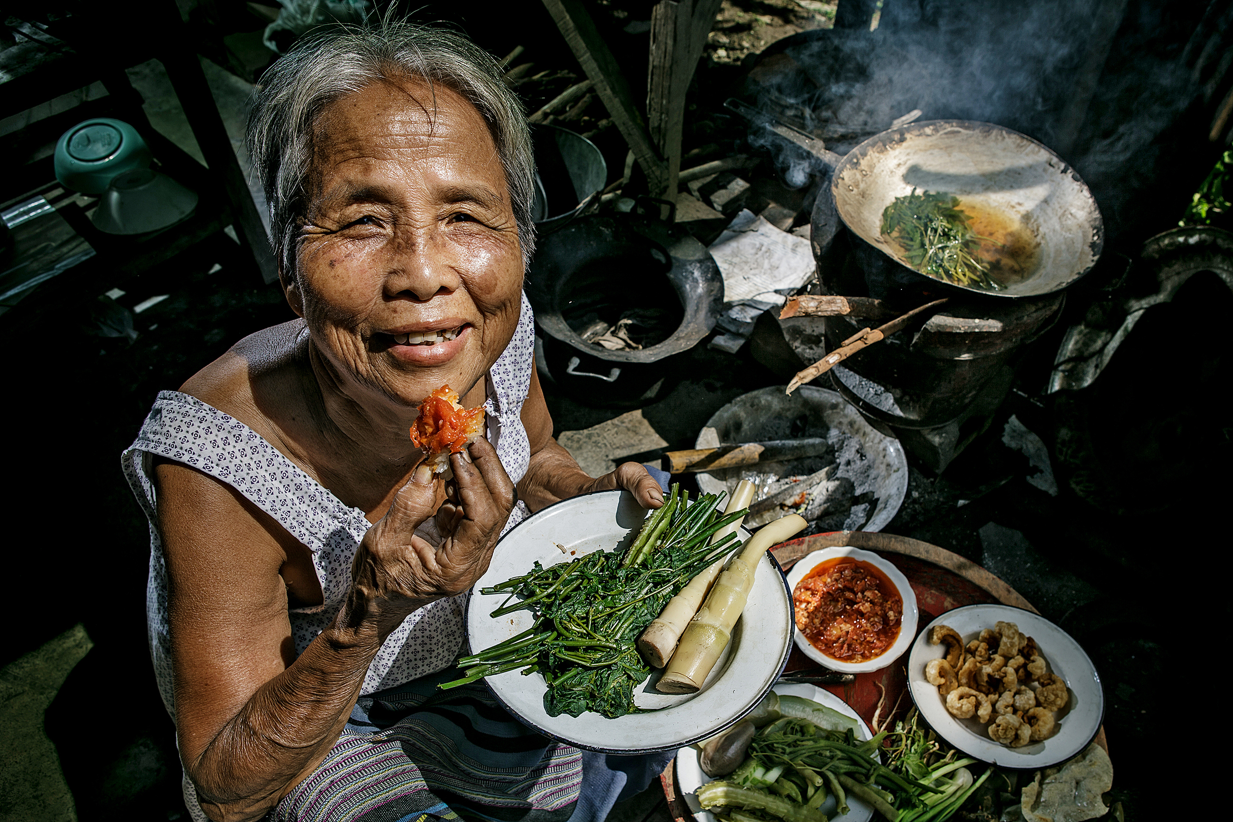 A local woman eating food