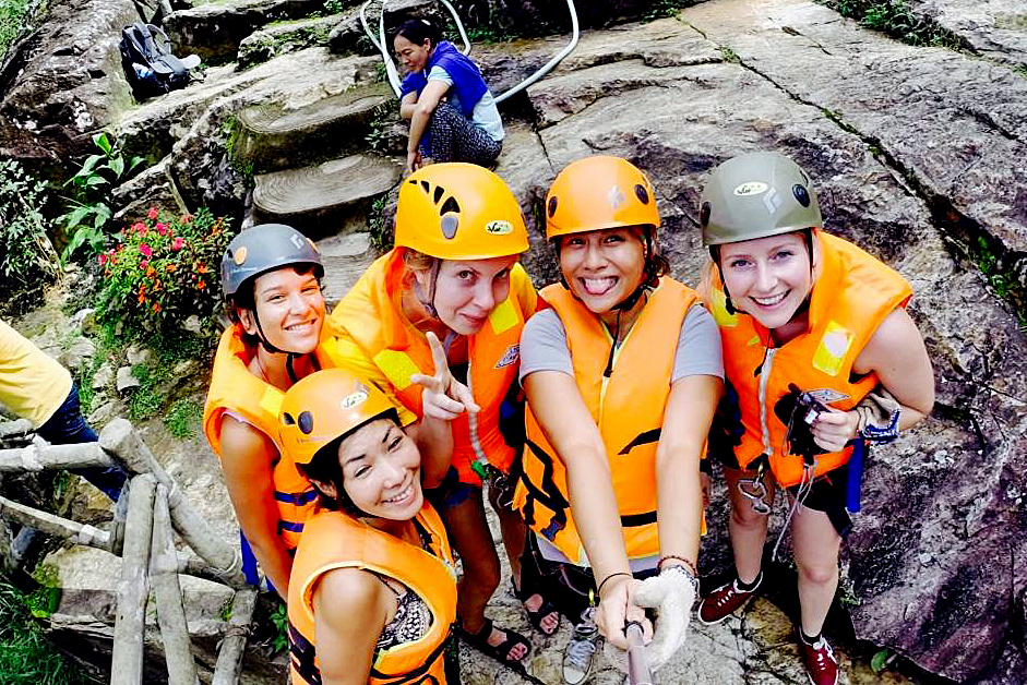 A group of women posing in canyoning gear