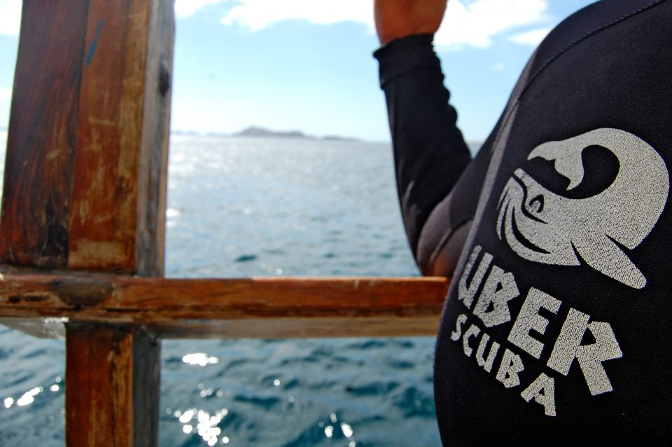 Close up of the uber scuba logo on a wetsuit