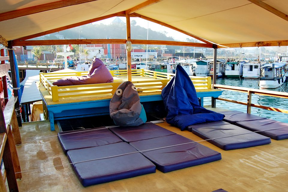 A boat full of mats and beanbags