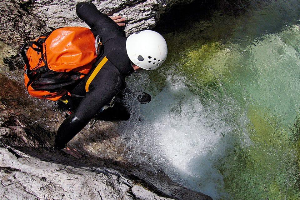 A man canyoning