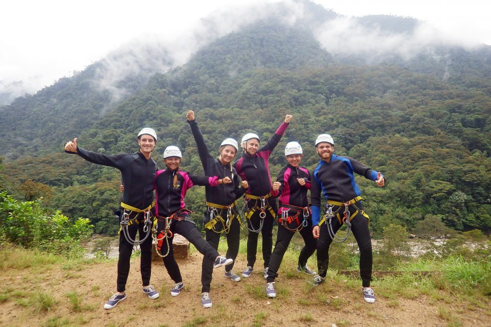 A group of people in canyoning gear