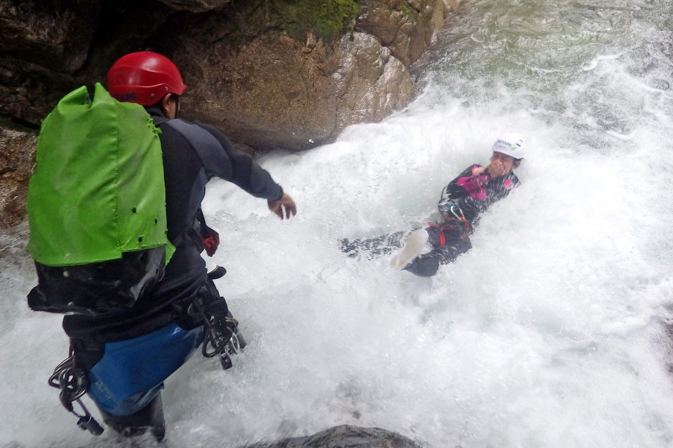 People jumping off a waterfall