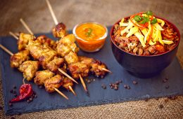 Chicken skewers and seafood on a slate