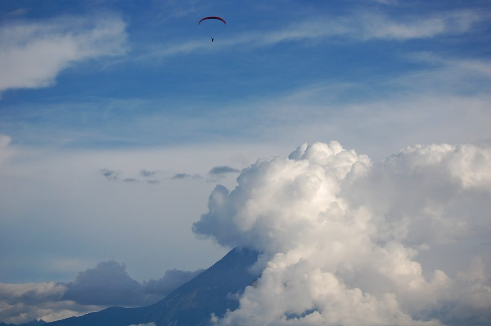 A paraglider in the sky