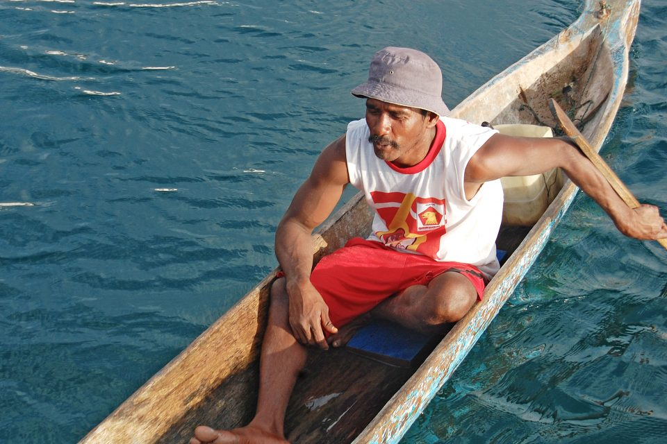A local man sitting in a canoe