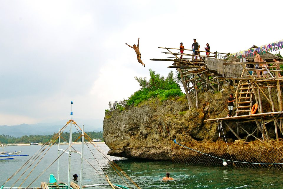 A man cliff jumping