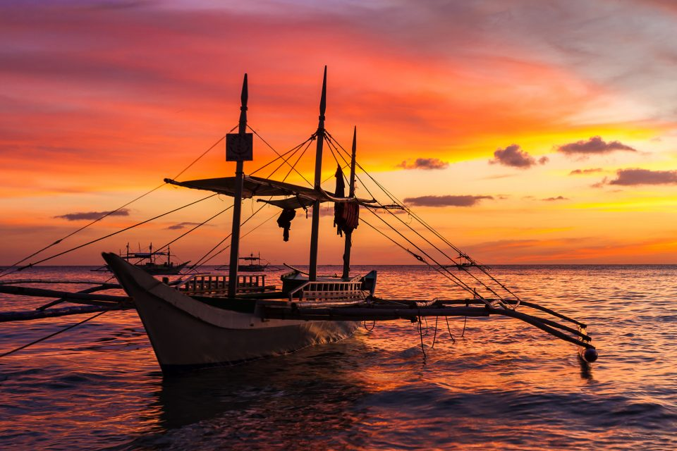 sail boat at sunset on boracay island
