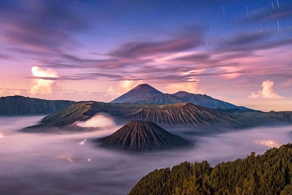 Volcano peaks through clouds