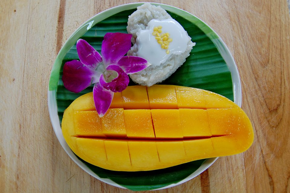Mango sticky rice on a banana leaf