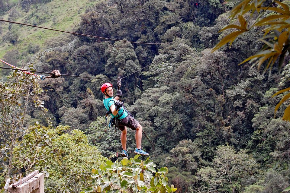 A man ziplining over the jungle