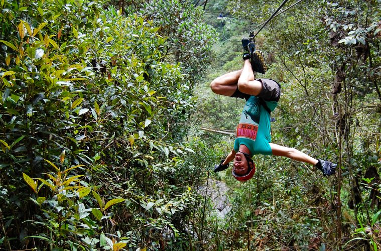 A man ziplining upside down