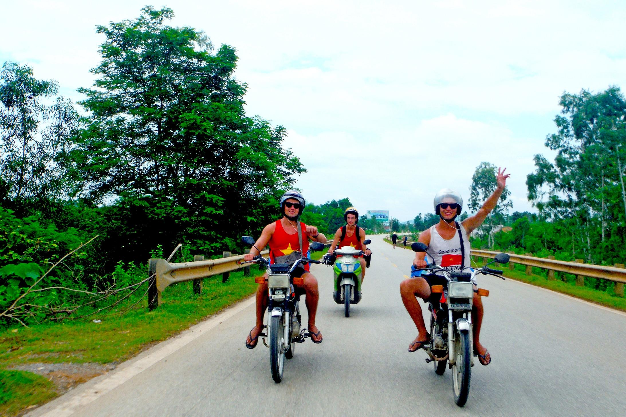 Men riding motorbikes towards camera