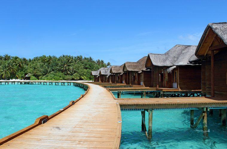 maldives huts by water