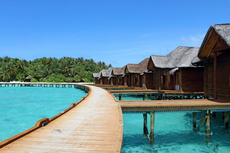 maldives huts by water
