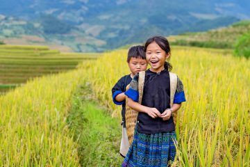 Children in a field in Vietnam