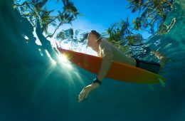 paddling out surfer